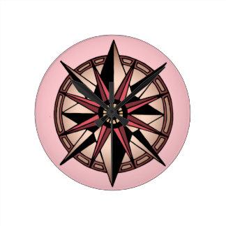 estrella color de rosa del compás reloj redondo mediano