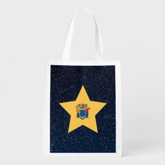 Estrella de la bandera de New Jersey en espacio Bolsas Para La Compra