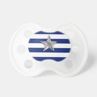 Estrella de plata náutica en rayas de azules chupetes