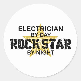 Estrella del rock del electricista por noche pegatina redonda