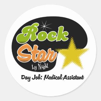Estrella del rock por noche - auxiliar médico del pegatina redonda
