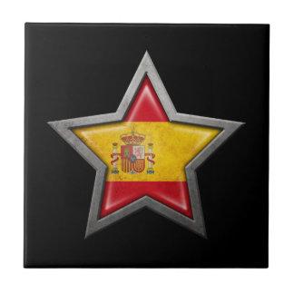 Estrella española de la bandera en negro azulejo