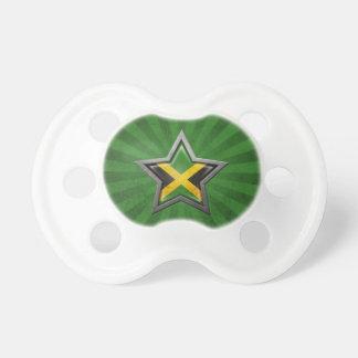 Estrella jamaicana de la bandera con los rayos de  chupetes para bebés