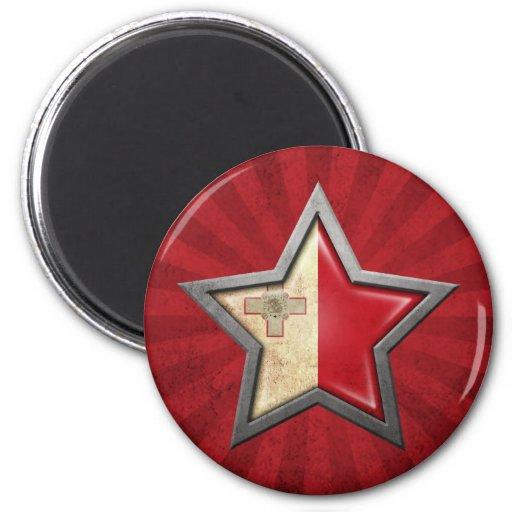 Estrella maltesa de la bandera con los rayos de la iman de nevera