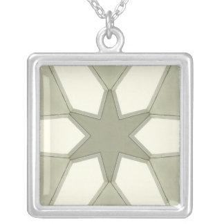Estrella verde en el collar verde y blanco