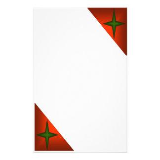 Estrella verde en triángulo rojo papeleria