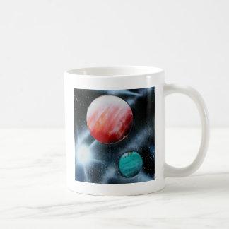 Estrella verde roja de los planetas y del blanco s taza básica blanca
