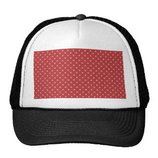 Estrellas atractivas del blanco en superficie roja gorros