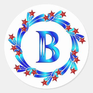 Estrellas azules del rojo del monograma de la letr etiqueta redonda