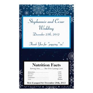 Estrellas azules y copo de nieve de la envoltura d tarjeta publicitaria
