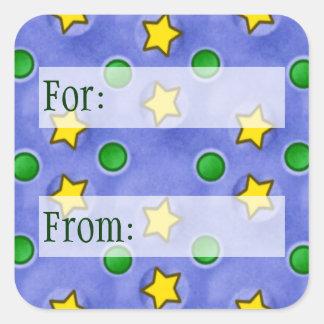 Estrellas azules y etiqueta del regalo de los