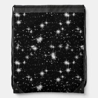 Estrellas brillantes brillantes en espacio mochilas