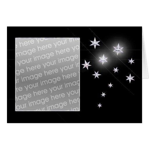 Estrellas de la plata en el negro (marco de la tarjeta de felicitación