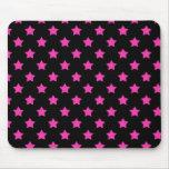 Estrellas de las rosas fuertes en modelo negro del tapete de ratones