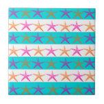 Estrellas de mar del tema de la playa del verano e tejas
