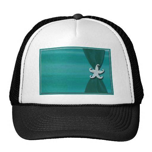 Estrellas de mar en cinta de la aguamarina con el  gorra