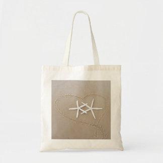 Estrellas de mar en la bolsa de asas del corazón