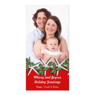Estrellas de mar en tarjeta roja, vertical de la tarjetas personales con fotos