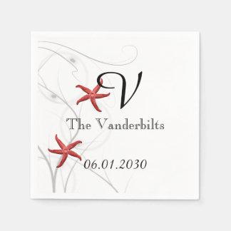Estrellas de mar rojas con el boda coralino de servilletas desechables