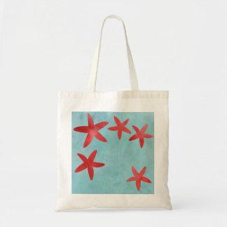 Estrellas de mar rojas y azules
