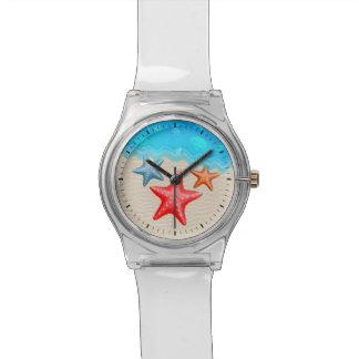 Estrellas de mar y Seashells Reloj