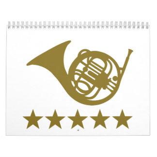 Estrellas de oro de la trompa calendarios de pared