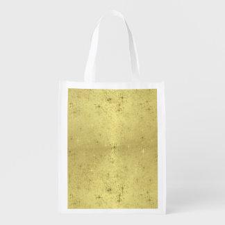 Estrellas de oro del navidad en el papel de la bolsas para la compra