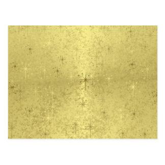 Estrellas de oro del navidad en el papel de la tarjeta postal