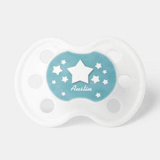 Estrellas del blanco en el regalo conocido de chupetes para bebés