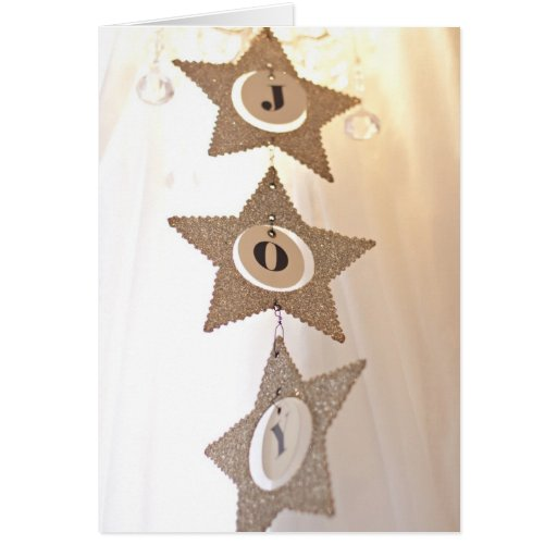 Estrellas del brillo de la plata de la tarjeta de