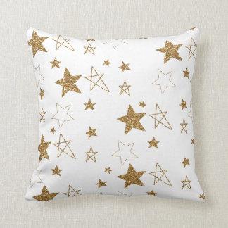 Estrellas del oro almohadas