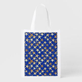 Estrellas del oro en azul de cobalto bolsas de la compra