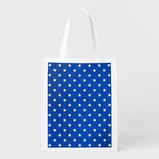Estrellas en textura de la tela bolsa de la compra
