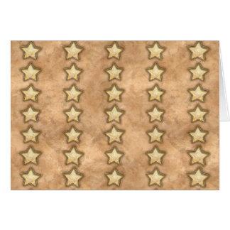 Estrellas martilladas del cobre felicitaciones