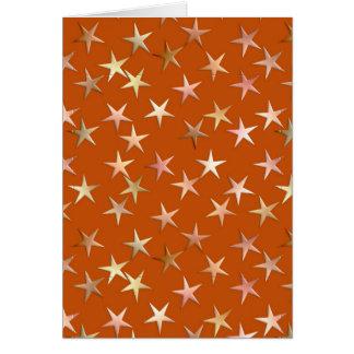 Estrellas metálicas oro pálido y sombras del cobr felicitacion