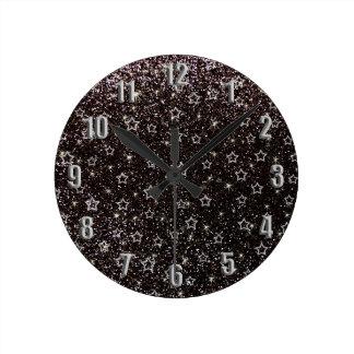 Estrellas negras del brillo reloj