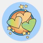 Estrellas y corazones pegatinas redondas