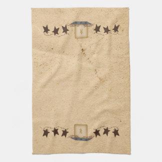 Estrellas y toalla de cocina oxidadas de la vela