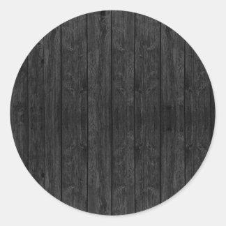 Estructura de madera negra de la textura de la pegatina redonda