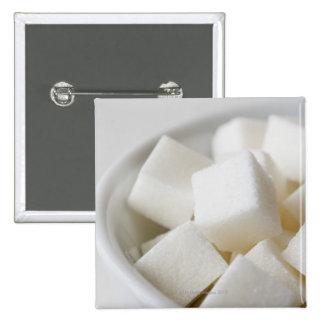 Estudio tirado de los cubos del azúcar en cuenco pin cuadrado