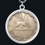 """Ethiopian coin necklace<br><div class=""""desc"""">featuring the image of the Lion of Judah--please note that it is not an actual coin but the image of a coin printed on a flat surface</div>"""