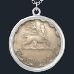 "Ethiopian coin necklace<br><div class=""desc"">featuring the image of the Lion of Judah--please note that it is not an actual coin but the image of a coin printed on a flat surface</div>"