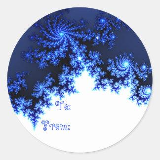 Etiqueta azul del regalo del copo de nieve del