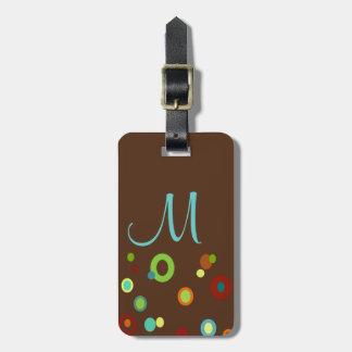 Etiqueta colorida con monograma del equipaje de lo etiquetas de equipaje