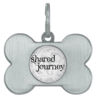 Etiqueta compartida del mascota del viaje placa mascota