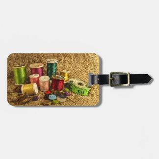 Etiqueta de costura del equipaje de las fuentes