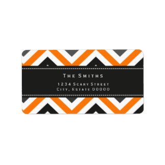 Etiqueta de dirección negra y anaranjada del galón