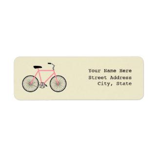Etiqueta de dirección rosada de la bicicleta