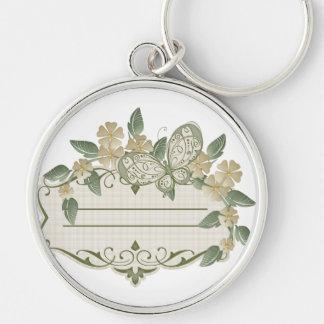 Etiqueta decorativa de la mariposa del estilo del  llavero redondo plateado