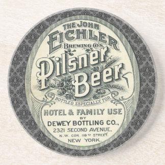 Etiqueta del anuncio de la cerveza de Pilsner del Posavasos Diseño